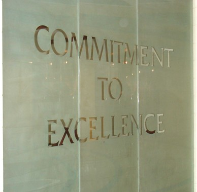 Tecumseh High School glass window Commitment To Excellence