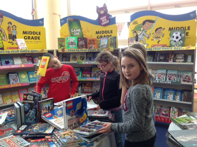 NCE students selecting books at book fair