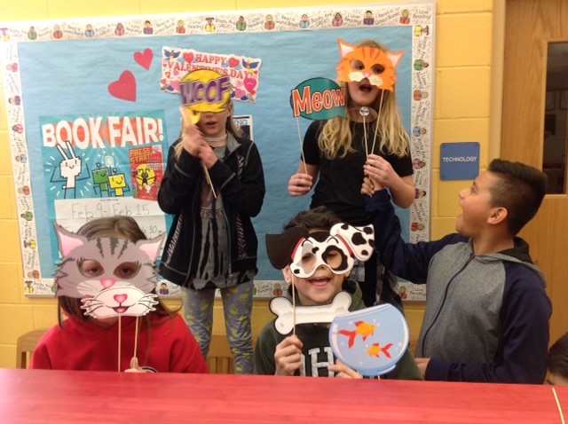 NCE students posing for a photo op at book fair