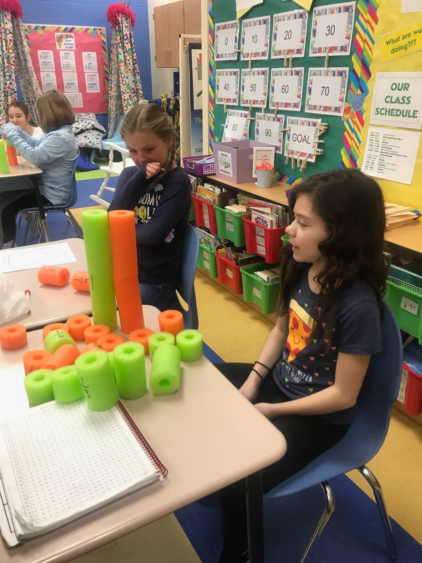photo of 4th grade math class using math manipulatives