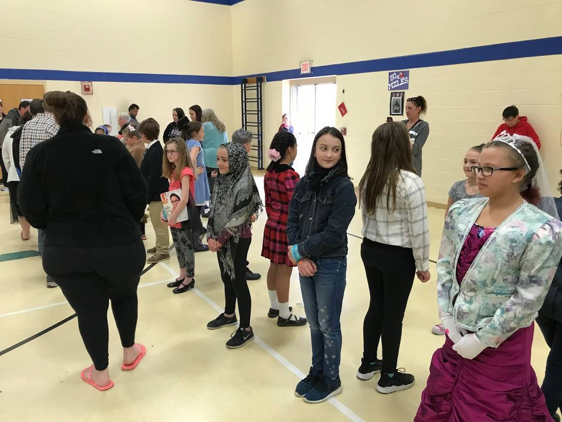 4th graders students standing still for Wax Museum day 2018