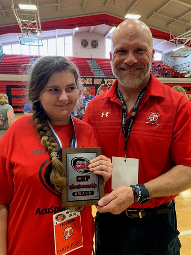 Craig Eier, Athletic Director awarding Rachel with the sportsmanship award.