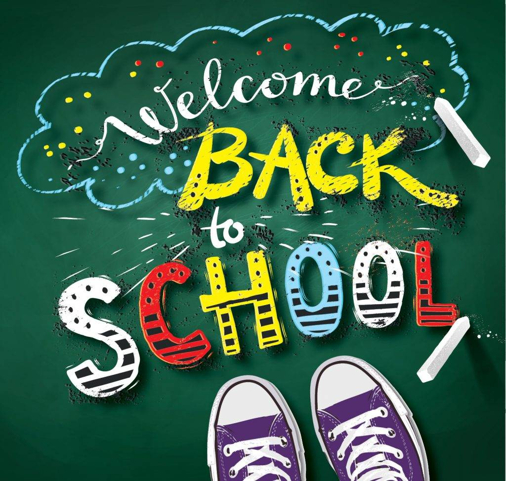 Welcome Back to School written in chalk on a green background