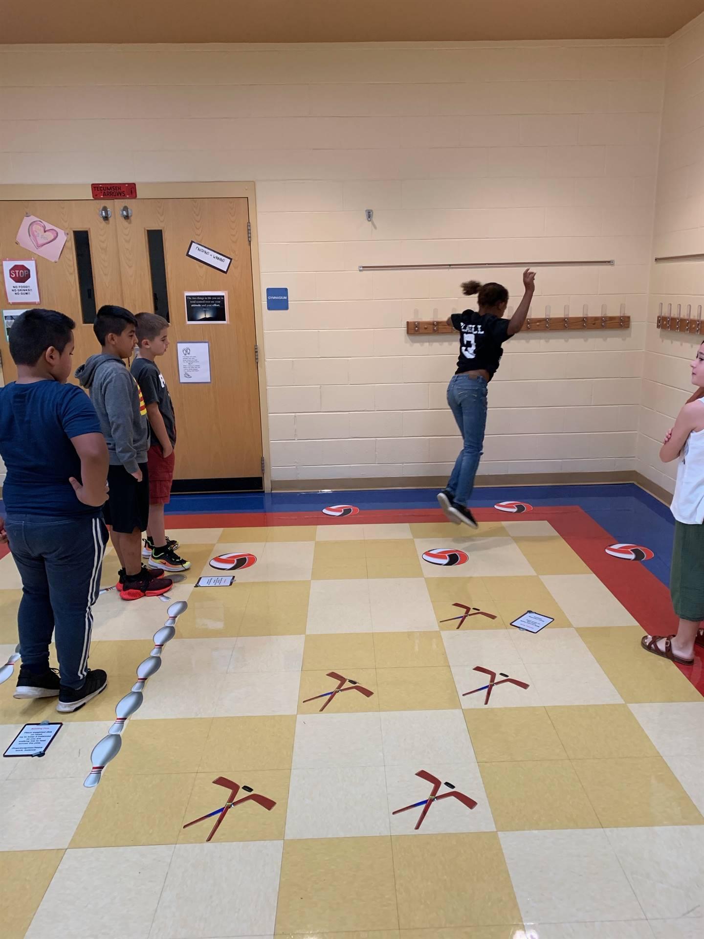 girl jumping up on sensory path at NCE
