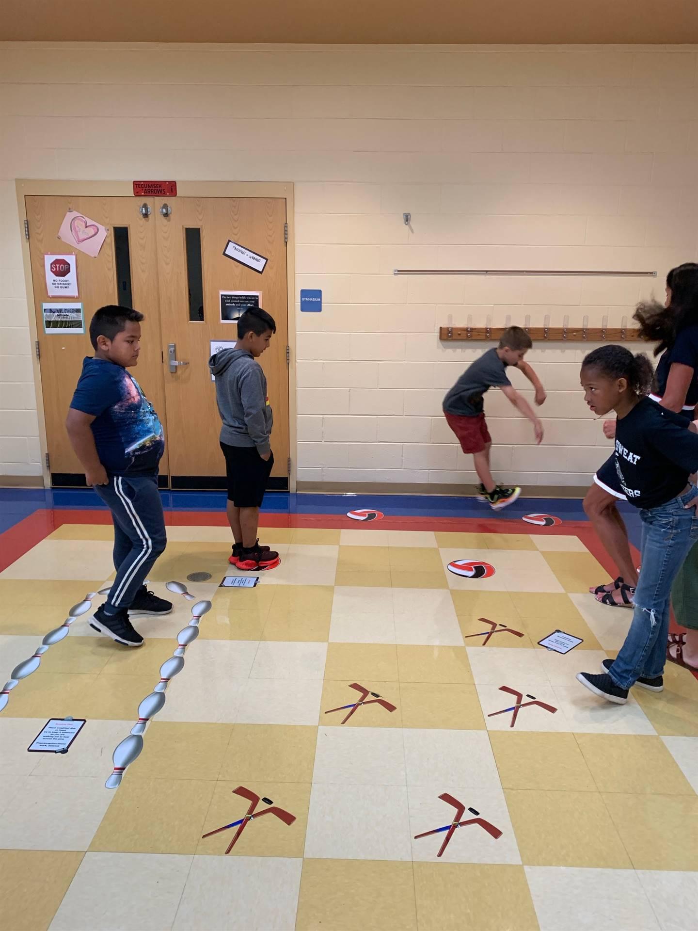 boy jumping forward on sensory path at NCE