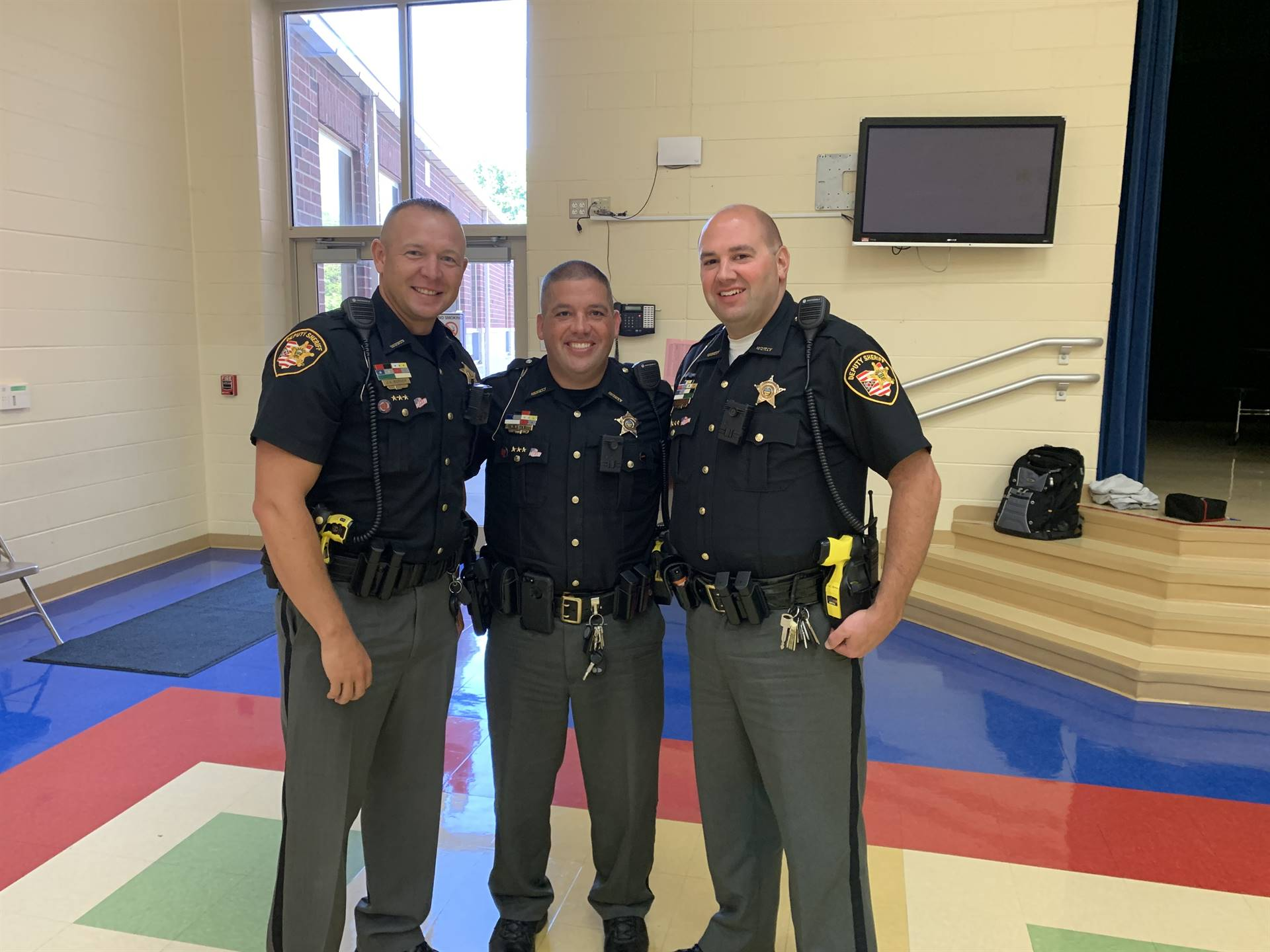 Three officers posing for a photo at NCE