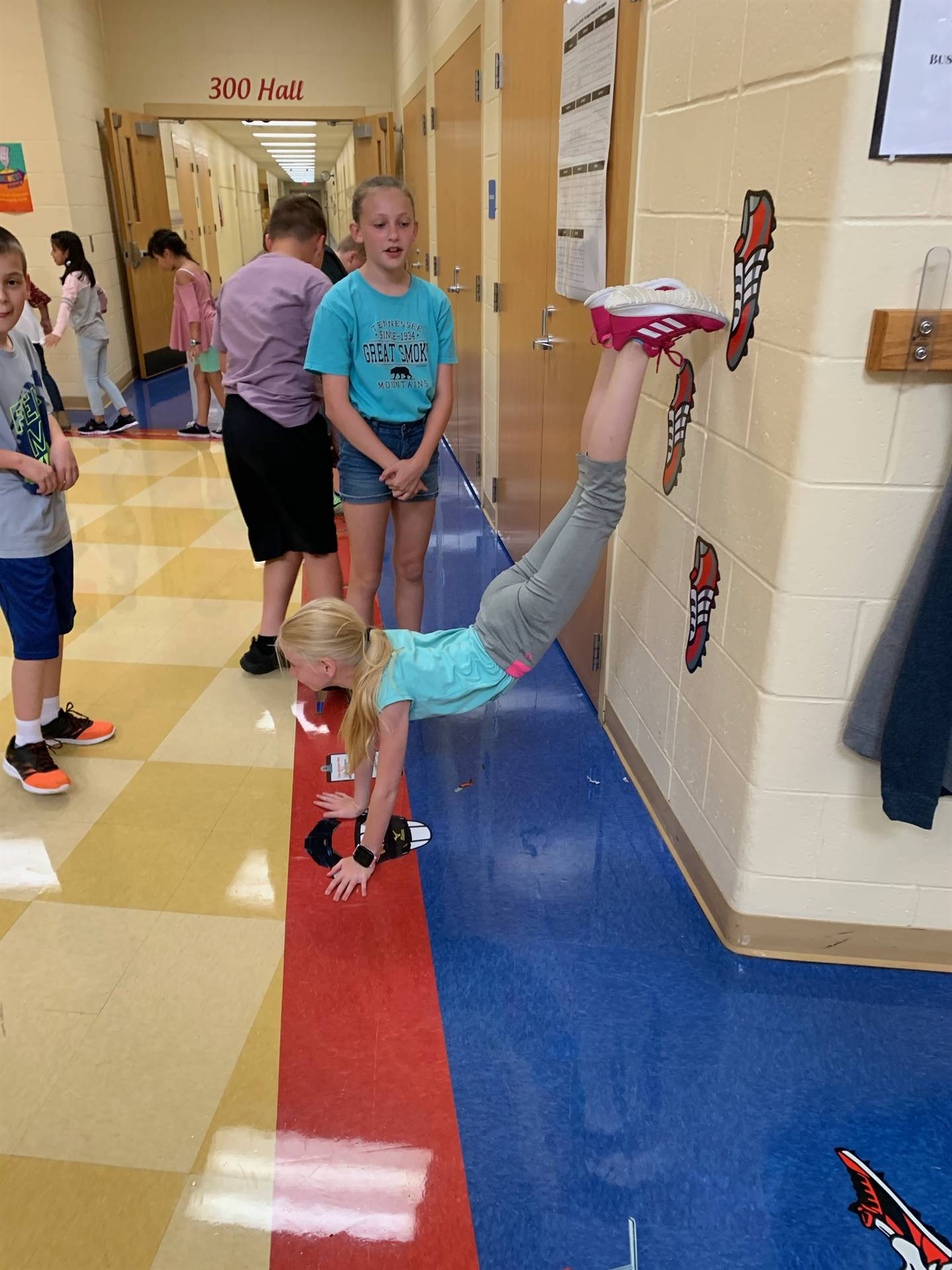 5th grade girl doing a handstand on the sensory path at NCE