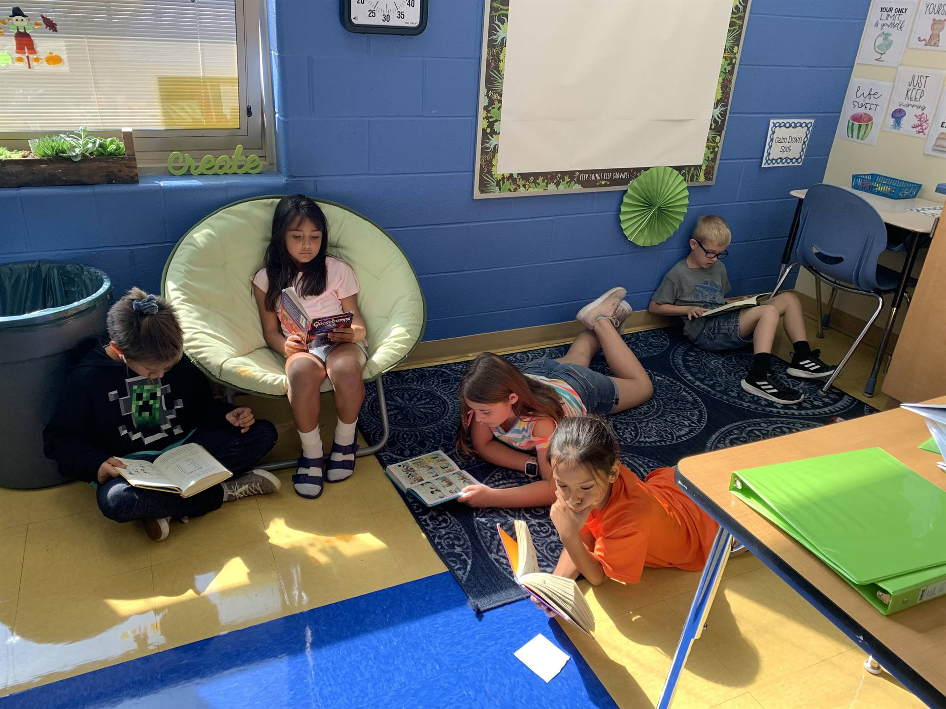 Student reading in the reading corner at NCE