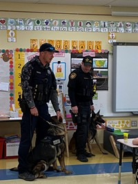 Canine Officers visited and explained what service their dogs provide.